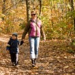 Mother and son in autumn forest — Stock Photo #8746703