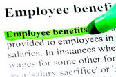 Employee benefits definition highlighted by green marker on white — Photo