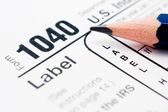 Filling tax forms 1040 — Stock Photo