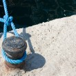 Knot on rope in dock - Stock Photo