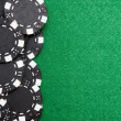 Red gambling chips on green felt background with copy space — Stock Photo