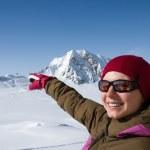 Woman pouinting mountains — Stock Photo