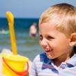 Small boy smiling on beach — Stock Photo