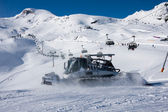 Snowcat and skilift in alps — Stock Photo