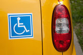 Handicapped sign on back of car — Stock Photo