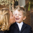 Mother kissing her son — Stock Photo