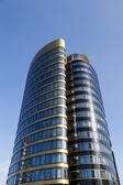 Modern office building over blue sky — Stock Photo