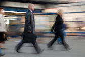 Group of rushing to work at the morning in intentional motion blur. — Stock Photo