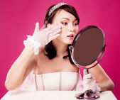 Bride with a mirror — Stock Photo