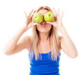 Woman holding two apples — Stock Photo
