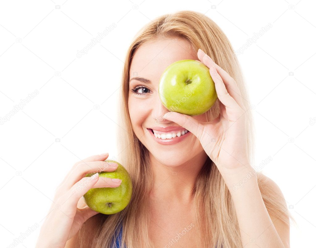Humorous portrait of a  young woman  holding two apples, isolated against white background  Stock Photo #10072040