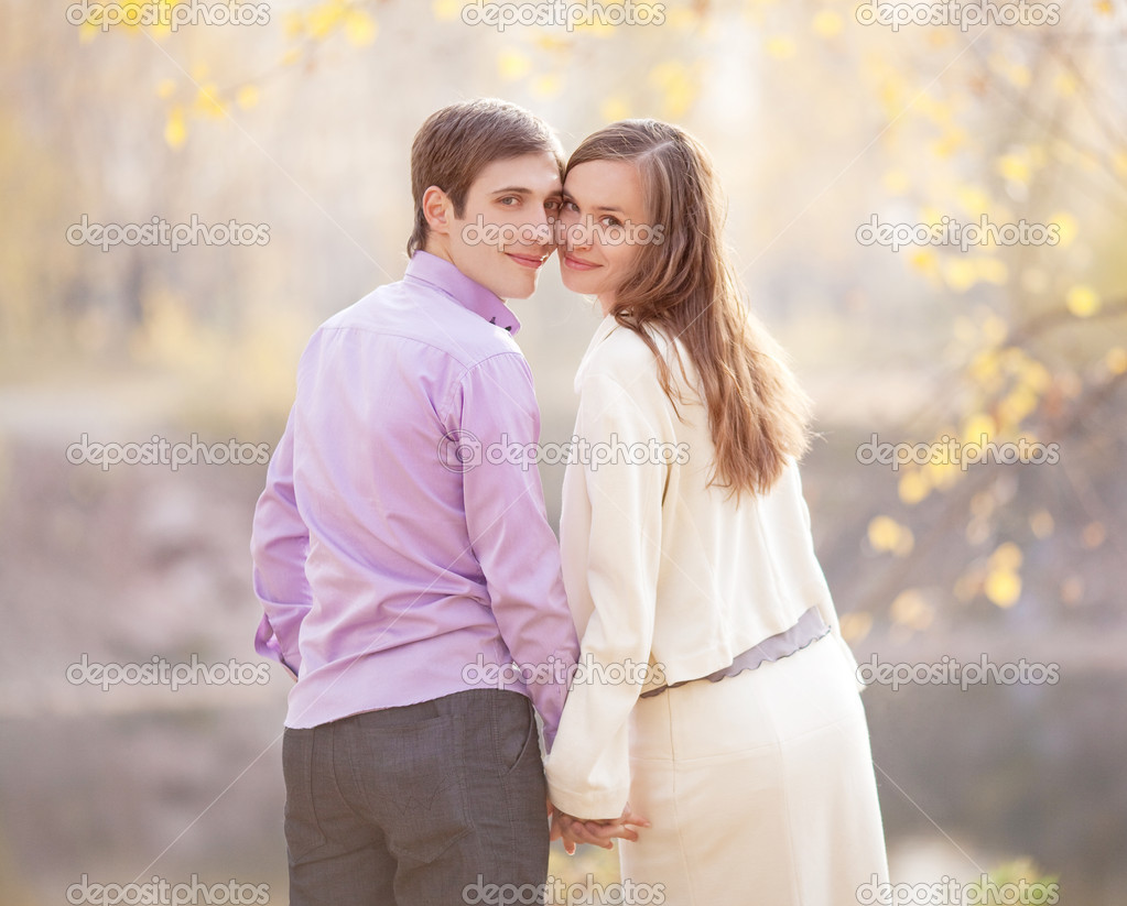 Low contrast portrait of a happy young couple  outdoor in the autumn park — Stock Photo #10231954