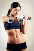 Woman with dumbbells — Foto Stock