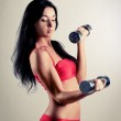 Woman with dumbbells — Stock Photo #8238093