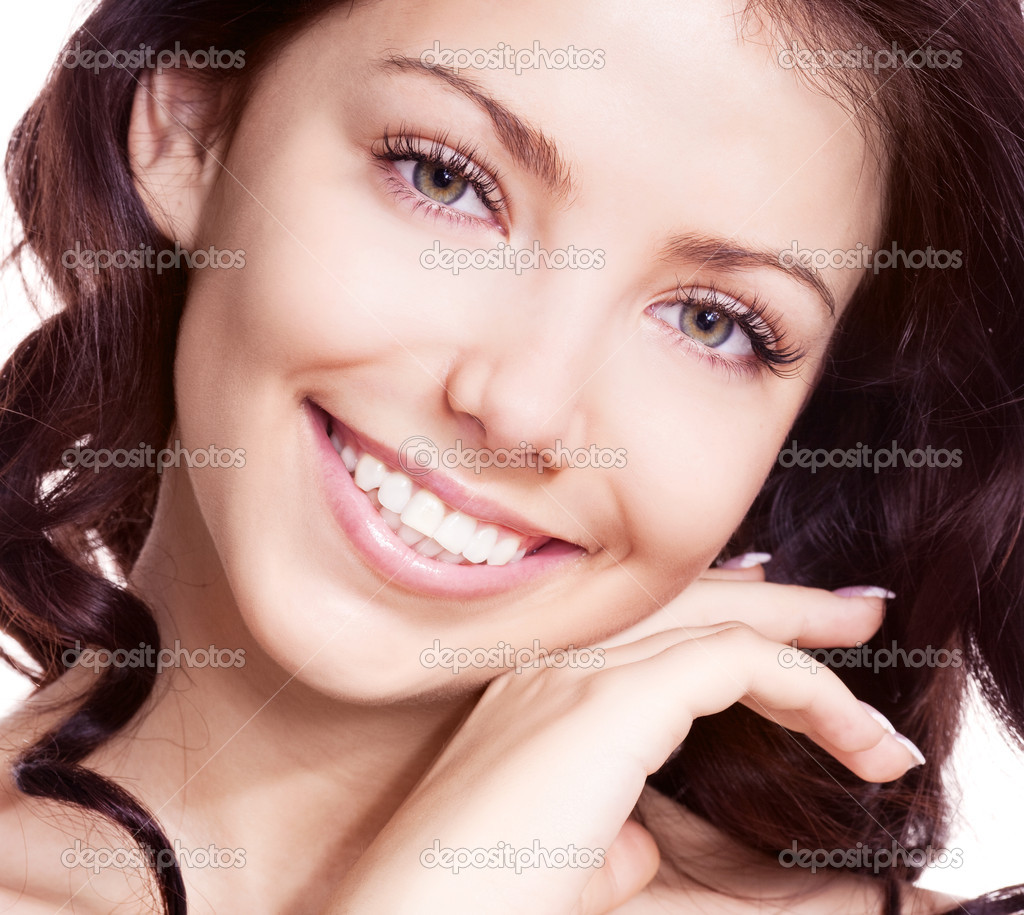 Portrait of a young beautiful smiling woman touching her face, isolated against white background — Stock Photo #8372532