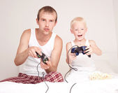 Father and son playing games — Stock Photo