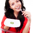 Woman eating peas — Stock Photo #8683335
