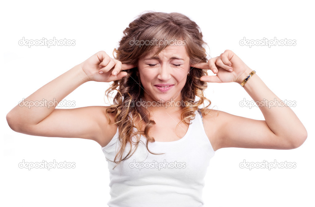 Portrait of an angry young woman closing her ears and refusing to listen to something , isolated against purple studio background  Stock Photo #8763445