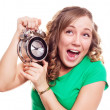 Woman with an alarm clock - Stock Photo
