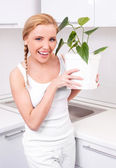 Housewife with flowers — Stock Photo