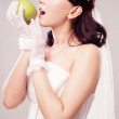 Bride eating an apple — Stock Photo #9066318