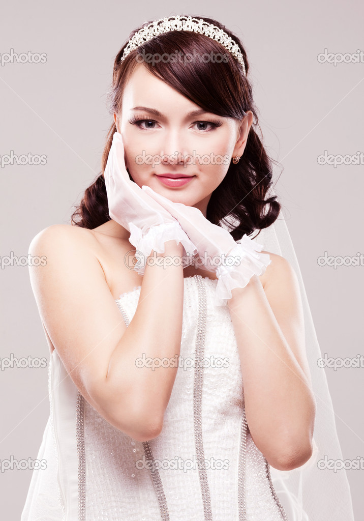 Beautiful happy bride, isolated against grey studio background — Stock Photo #9066124