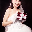 Bride with a present — Stock Photo #9093081