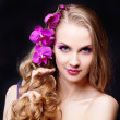 Woman with an orchid — Stock Photo #9156493
