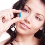 Woman taking pills — Stock Photo #9273224