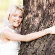 Woman with a tree — Stock Photo #9329122