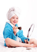 Child applying makeup — Stock Photo