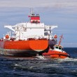 Tugboat towing tanker — Stock Photo #10725644