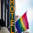 Hotel with The Rainbow Flag symbol of homosexual - Stock Photo