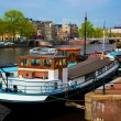 Amsterdam old town canal, boats. - Stock Photo