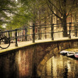 Amsterdam. Romantic bridge over canal. — Stock Photo