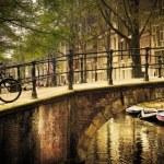 Amsterdam. Romantic bridge over canal. — Stock Photo