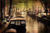 Amsterdam. Romantic canal, boats. — Stock Photo