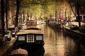 Amsterdam. Romantic canal, boats. — Stock Photo