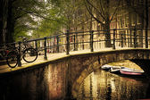 Amsterdam. Romantic bridge over canal. — Foto de Stock
