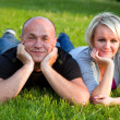 Adult happy couple together on grass — Stock Photo