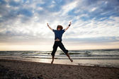 Happy young man jumping — Stock Photo
