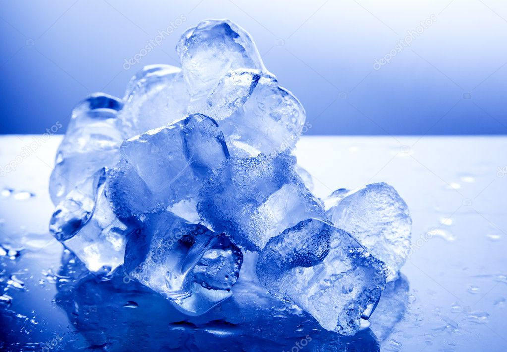 Ice cubes on blue light background — Stock Photo #8958144