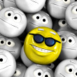 Happy smiling emoticon face among others — Stock Photo