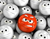 Angry emoticon face among others — Stock Photo