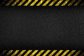 Dark background with yellow caution stripes — Stock Photo