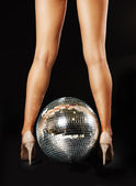 Woman legs and disco ball — Stockfoto