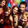 Stock Photo: Happy friends on a party