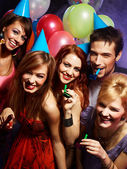 Happy friends on a party — Stockfoto