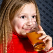 Beautiful little girl with glass in hands — Stock Photo