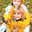Mother and son in autumn park — Stock Photo #8095082
